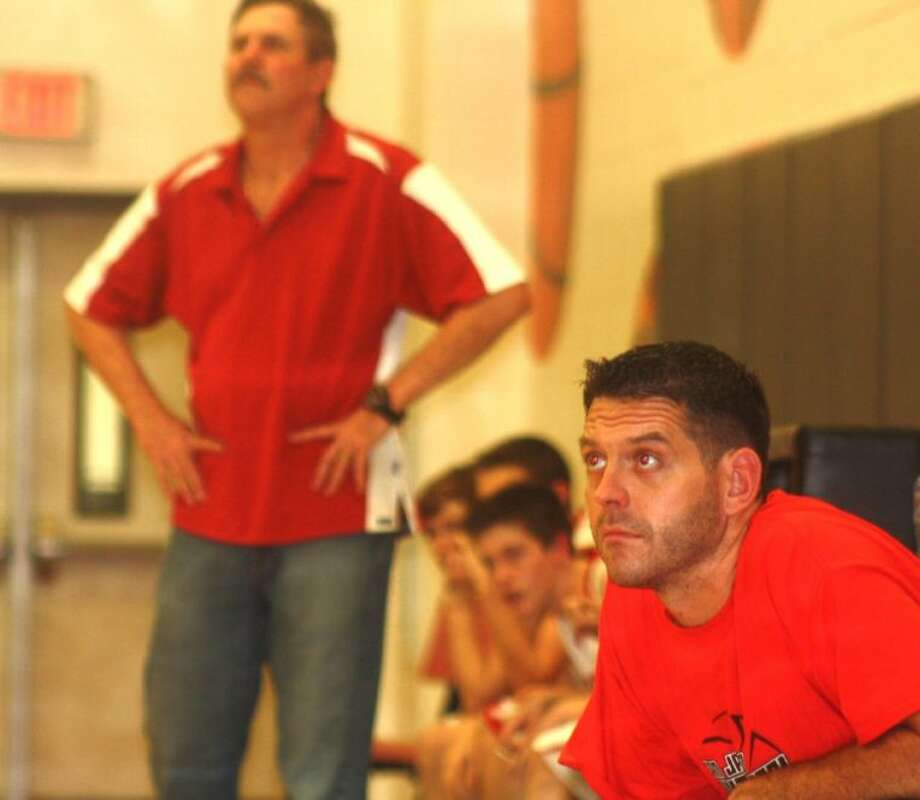 San Jacinto Intermediate coach and tournament director Ryan Nygaard and Deer Park Junior High coach Harold Flynn watch the action unfold during the tournament. Deer Park won this game 32-27. Photo: Robert Avery