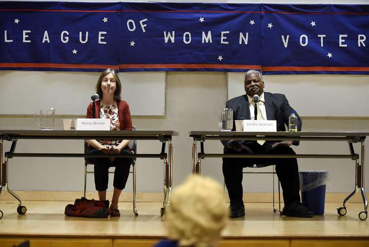 The candidates sit on stage during a League of Women Voters debate between District 9 state Senate hopefulls Nancy Skinner, left, and Sandre Swanson at Berkeley City College in Berkeley, CA Saturday, October 1, 2016.