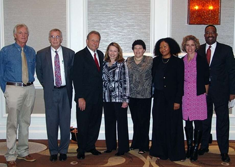 Pictured at the event are Dr. Robert O. Brinkerhoff, Ed.D., UH College of Technology Dean William Fitzgibbon, UH Sugar Land Associate Vice Chancellor Dick Phillips, Sugar Land Director of Economic Development Regina Morales, UH ExHRD Program Facilitator Bonnie Rogers, UH ExHRD Program Coordinator Consuelo Waight, UH Human Resource Development Associate Professor Holly Hutchins and UH College of Technology Human Resource Development Advisor Torrence Sparkman. Photo: Courtesy City Of Sugar Land
