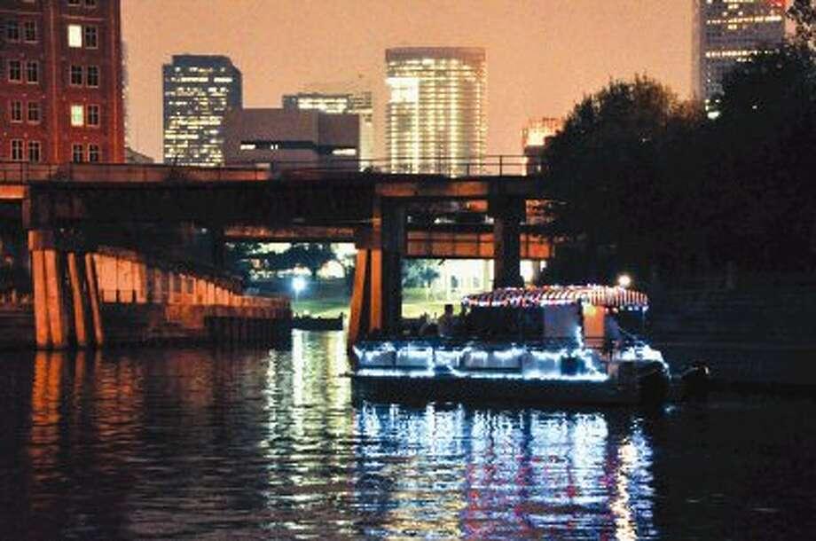 For 30 magical minutes, Houstonians can drift down Buffalo Bayou at night on a pontoon boat, thanks to the Buffalo Bayou Partnership's Holiday Boat Cruise.