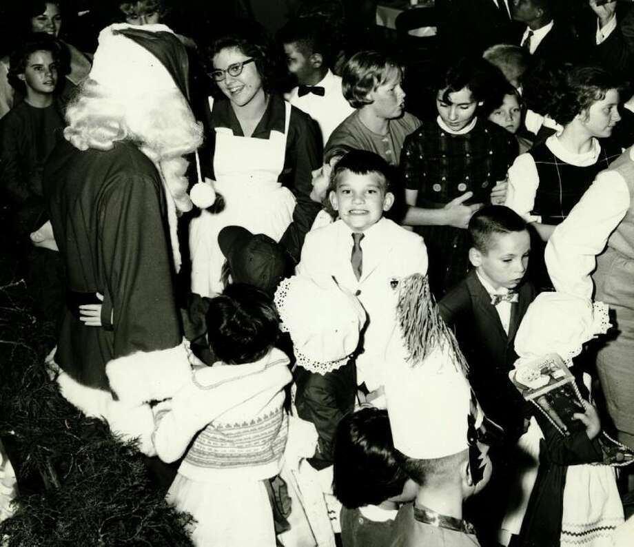 This photo, possibly dating to the 1960s, illustrates how local Rotarians helped make Christmases bright for orphaned and delinquent girls at the Harris County Training School for Girls during the first half of the 20th Century. Later accredited by the state, the school became known as the Mary Burnett School and was among several children's homes operated by the Harris County Probation Department.