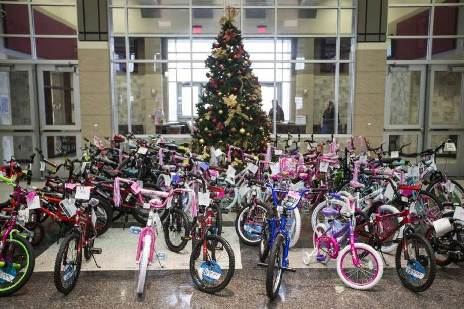 Bikes wait to be picked up from the Summer Creek High School Bicycle Toy Drive Dec. 18, 2013, at Summer Creek High School. Bikes will be donated to needy students at the feeder and elementary schools in the area. Photo: ANDREW BUCKLEY