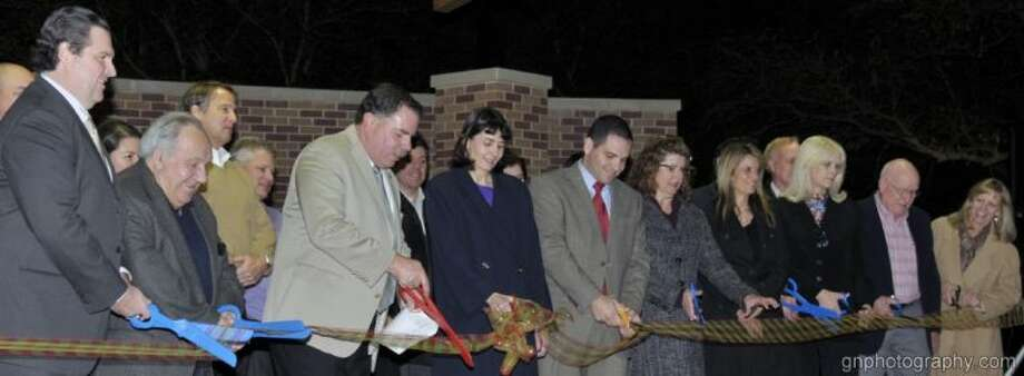 Bellaire elected officials joined members of the nonprofit PATRONS for Bellaire Parks, the volunteer Parks Board and Parks and Recreation Department staff to cut the ribbon for a new performance pavilion and great lawn at Bellaire Town Square. Photo: Gary Nathanson