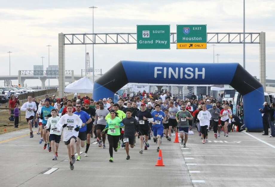 Runners start in the 5K Run at the Party on the Parkway Grand Opening Celebration in Katy on Saturday, Dec. 14., 2013. The party was to celebrate the opening of State Highway 99/Grand Parkway Segment E from I-10 to U.S. 290. Photo: Alan Warren