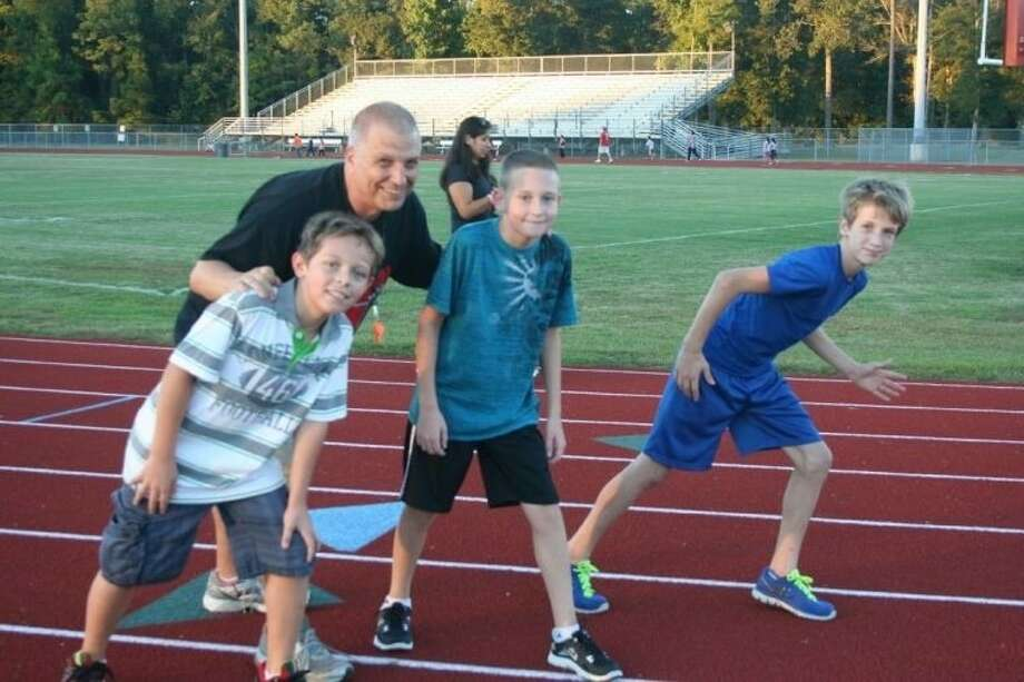 Fifth-grade Greenleaf Elementary student Mikey Pratt (bottom left) unexpectedly died following a collapse after a charity run on Saturday, Dec. 14. Pratt, a member of the Splendora Youth Running Club, participated in several runs throughout the year, under the leadership of Coach Bill Horewitch and along with his friends and fellow teammates Zachary Coats and Cooper Nelson (pictured with Pratt). Photo: STEPHANIE BUCKNER