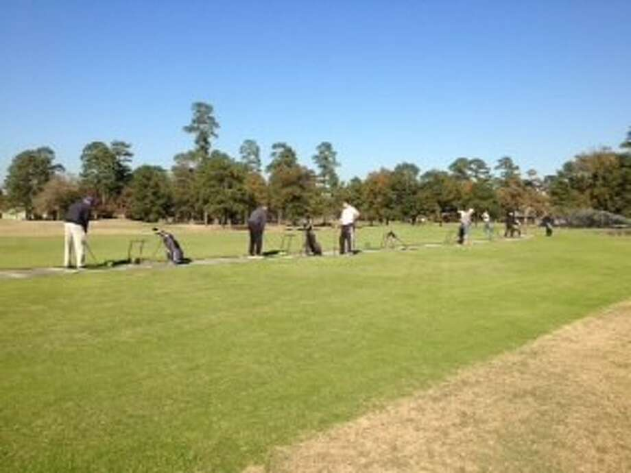 Residents try out the driving range for the first time at the Golf Preserve of Atascocita.