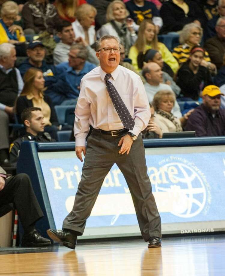 "Southern Illinois coach Barry Hinson yells to his team during a game against Murray State on Tuesday in Murray, Ky. Hinson lambasted his players after their 73-65 loss, calling them ""uncoachable,"" a ""bunch of mama's boys"" and comparing disciplining his young team to housebreaking a puppy."