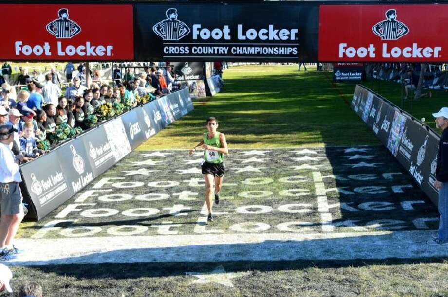 Strake Jesuit senior Frank Lara crosses the finish line Saturday afternoon at the 2013 Footlocker Cross Country National Finals in San Diego, Calif. Lara is one of the top distance runners in the state and the country and was running his second national meet in just two weeks. He helped lead the Strake Jesuit cross country to another 5A state meet in November. Photo: Bruce Wodder