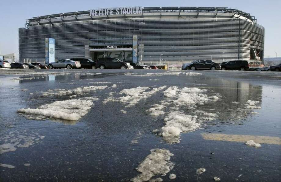 Snow and slush from Tuesday's snowfall is seen outside MetLife Stadium on Wednesday in East Rutherford, N.J. Later in the day, officials demonstrated snow removal and melting machinery and outlined emergency weather scenarios and contingency plans for the Super Bowl in February.