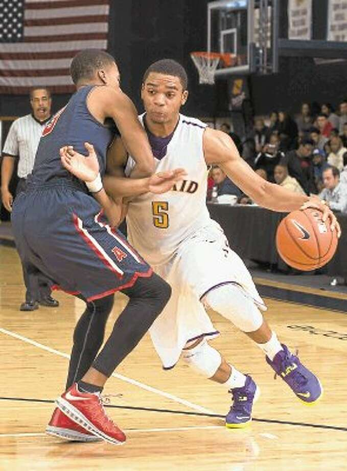 Kinkaid forward Jeff Roberson brings into an Atascociate defender while trying to get to the basket during a recent Falcons' non-conference game. The Falcons are presently 9-2 on the season and will play in the Austin Westlake tournament after Christmas before coming back in January to start play in the Southwest Preparatory Conference South Zone. Roberson is a four-year starter who has led the team in scoring during the first month of the season. Photo: Kevin B Long / ©2013 Gulf Coast Shots. All rights reserved