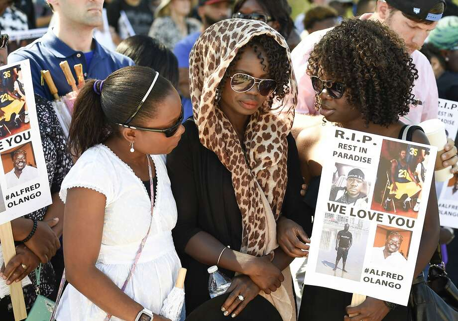 Winnie Olango (center) is consoled by friends before a protest march in El Cajon (San Diego County) over the fatal police shooting of her brother, Alfred Olango, a refugee from Uganda. Photo: Denis Poroy, Associated Press