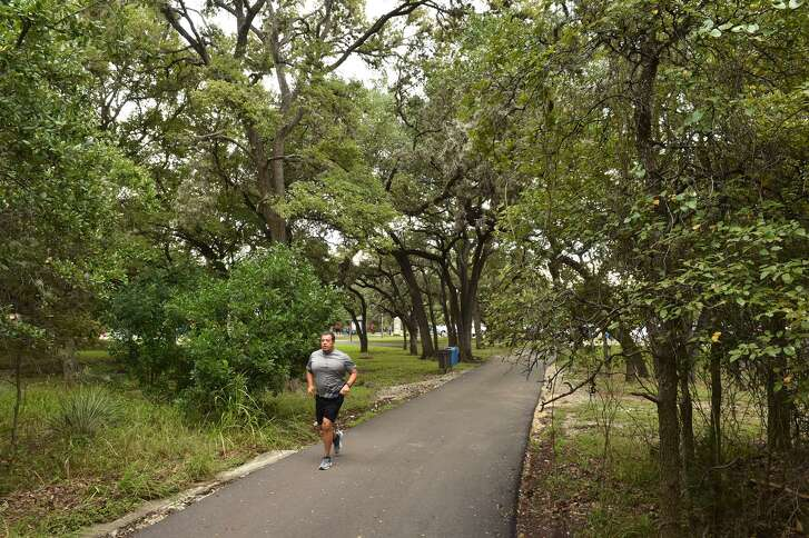 Greg Colunga goes for a morning run in McAllister Park in 2016.