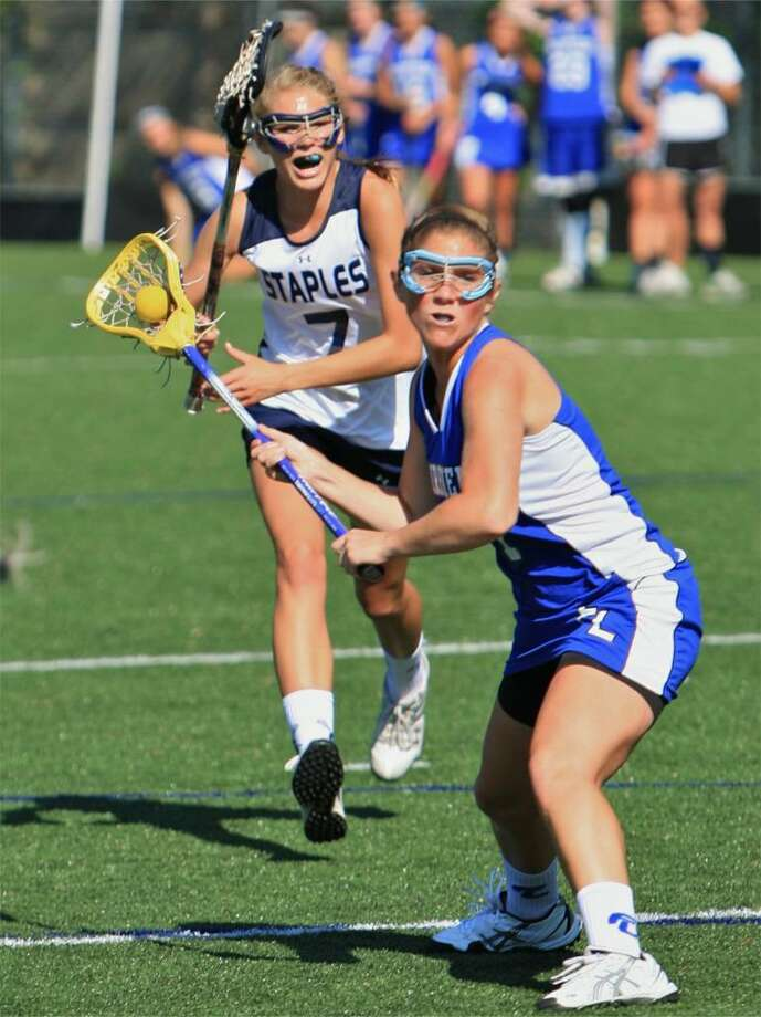 Fairfield Ludlowe's Hayley Welke fires a goal in the first half of the Falcons' 9-8 win over Staples on Wednesday in Westport. Photo: Steve Stearns, Steve Stearns For The Fairfield Citizen