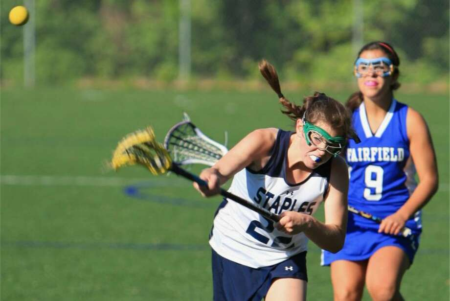 Staples sophomore Jessie Ambrose scores in a 9-8 home loss to Fairfield Ludlowe on Wednesday. Photo: Steve Stearns For The Westport News