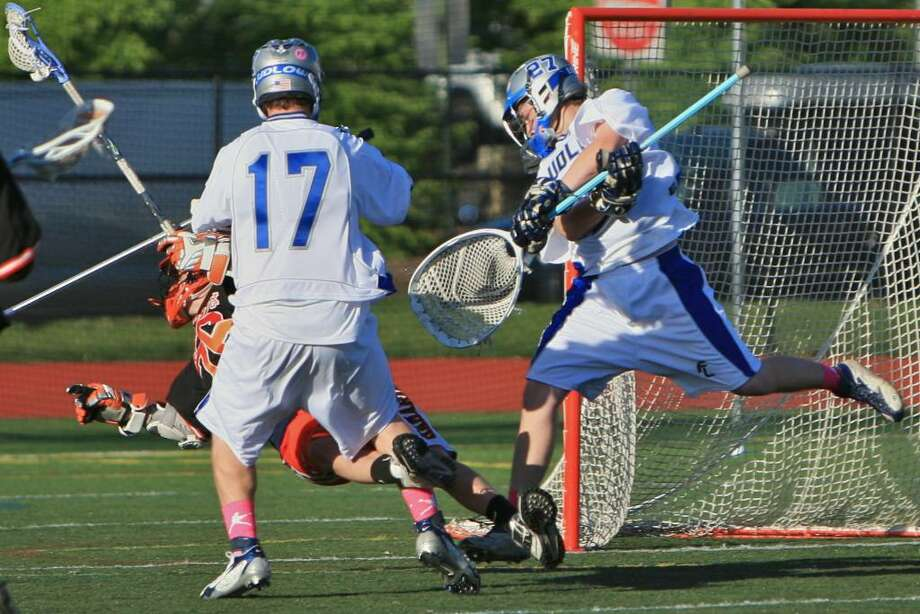 Fairfield Ludlowe boys lacrosse netminder Henry Boyd makes a save in Ludlowe's 6-5 loss to Mamaroneck (N.Y.). Ludlowe's schedule has been hellacious and does not get easier. Photo: Steve Stearns, Steve Stearns For The Fairfield Citizen