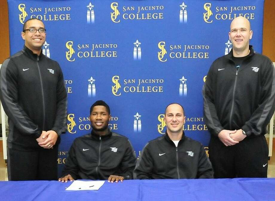 Gary Akbar (seated, left) prepares to sign his National Letter of Intent to play basketball and continue his education at Kent State University. With him are Assistant Coach Jeff Mailhot (left), Head Coach Scott Gernander (seated, right), and Assistant Coach Albert Talley. Photo credit: Jeannie Peng-Armao, San Jacinto College marketing, PR, and government affairs department.