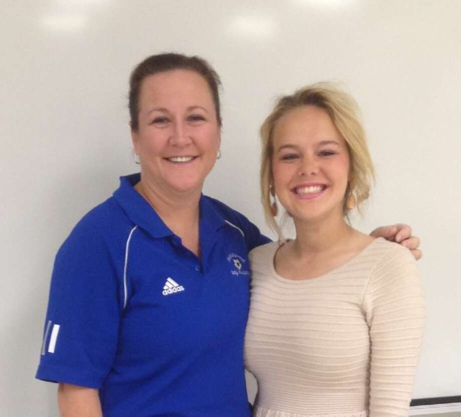 Friendswood girls' head soccer coach Laura Peter is flanked by Lady Mustang forward Taylor Rue, who was recently named to the all-Region VI team by the National Soccer Coaches Association of America. Photo: SUBMITTED PHOTO