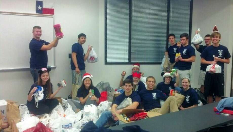 Kingwood High School National Honor Society members sort, count and pack the donated goods.