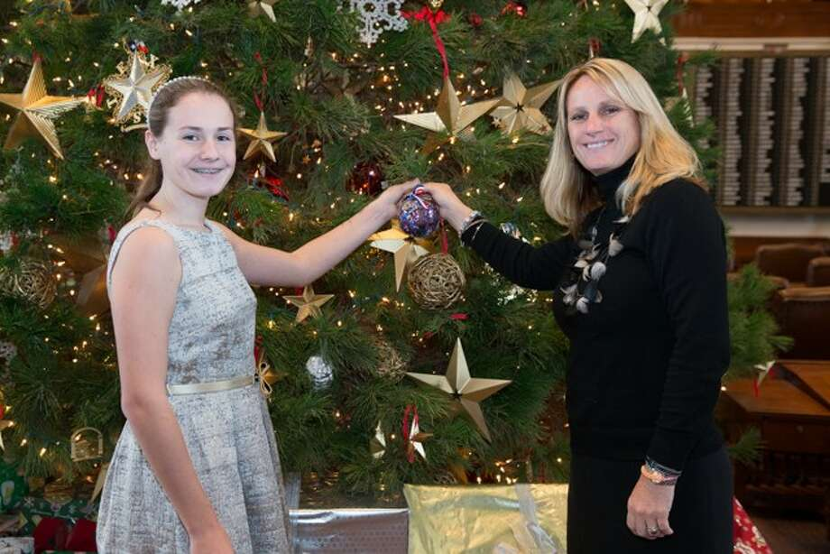 Janet and Brianna Huberty had the honor of placing the 2013 Ornament for District 127 on the Texas House Christmas Tree in the Chamber of the Texas House of Representatives at the Texas Capitol. The tree is set-up and decorated in December each year, and remains there through the holiday season for visitors to enjoy.