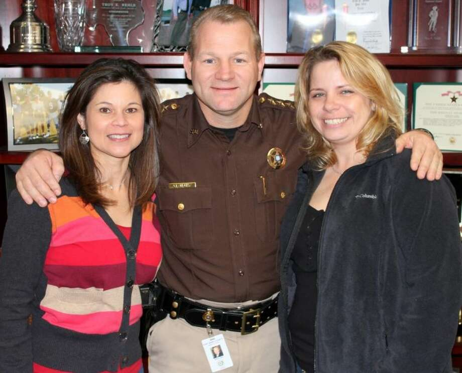 The Third Annual Deputy John Norsworthy Blood Drive is set for Friday, Dec. 27 at the Gus George Law Enforcement Academy, 1521 Eugene Heimann Circle in Richmond. Preparing for the event are, from left, Brenda DeFrayne, Gulf Coast Regional Blood Center; Sheriff Troy E. Nehls; and Melissa Norsworthy. Photo: Courtesy FBCSO