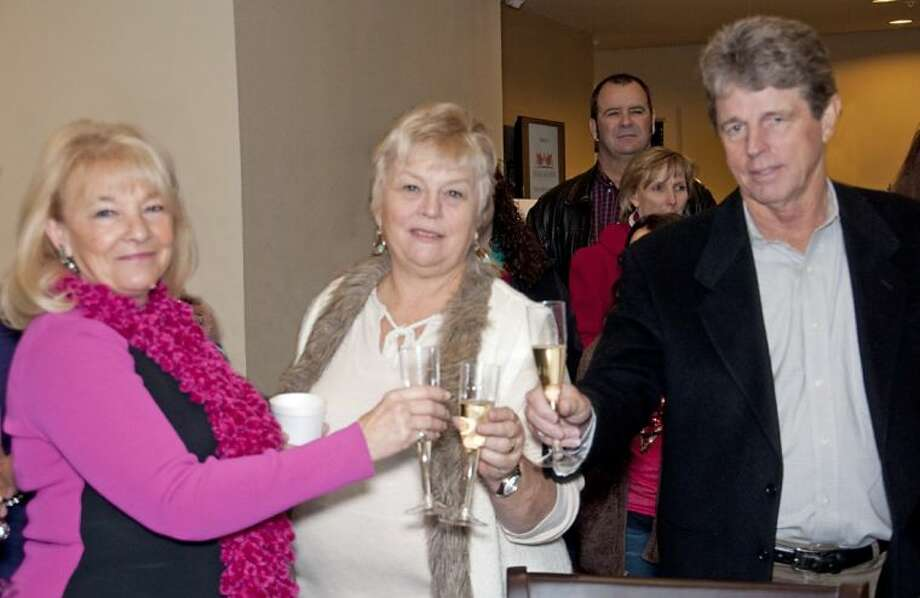 Ballard House Executive Director Ginger Hopper (left), and Monty Ballard (right) toast the opening of the Ballard House. Photo: Submitted Photo