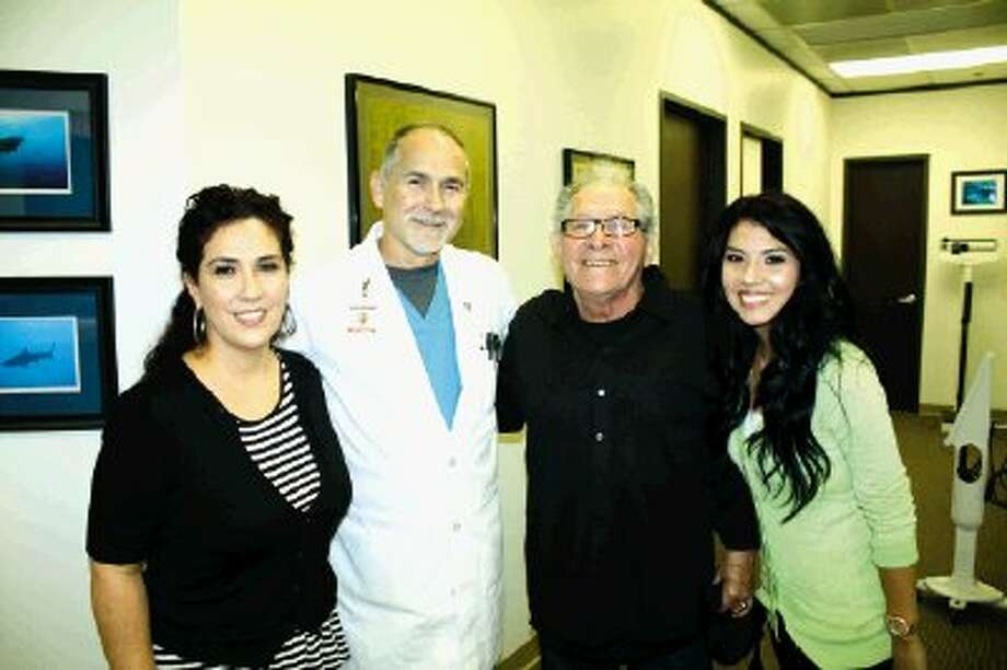 Dr. Kent Kossoy, second from left, reunites with his patient Joe Valdez with his granddaughter and his daughter a month after receiving da Vinci surgery to remove his colon cancer.