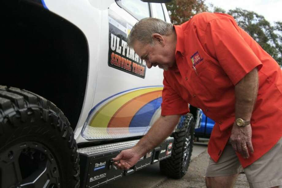 Phil's Car Care owner Phil Wofford checks out some of the storage units on the fully decked out Federated work truck he won from the Truck U tv show.