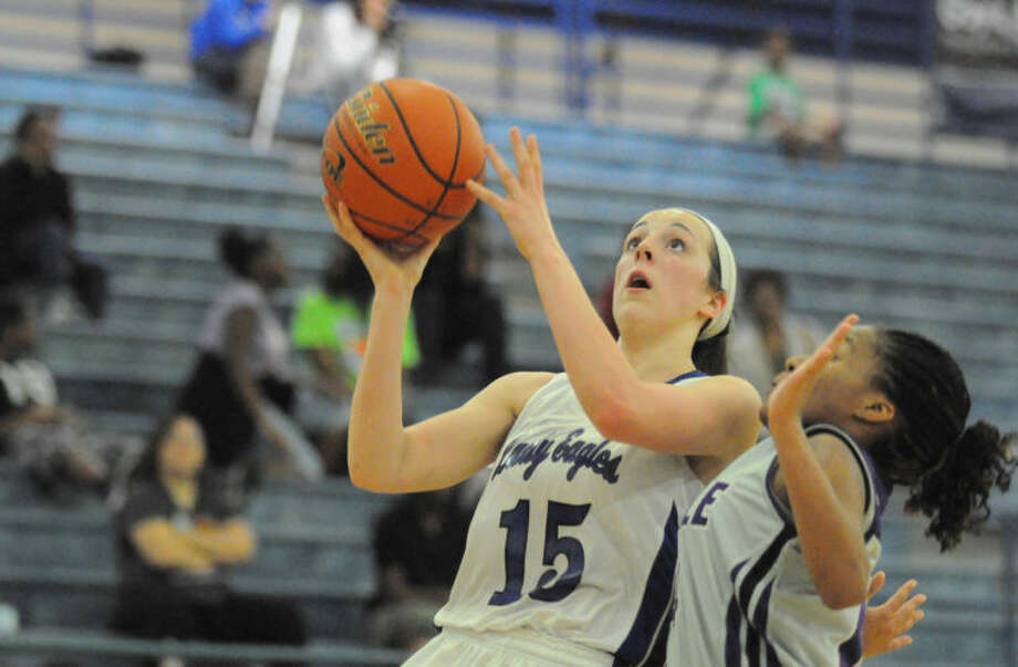 New Caney's Savannah Fleming goes up for a layup against Humble on Friday at New Caney High School. Photo: Keith MacPherson