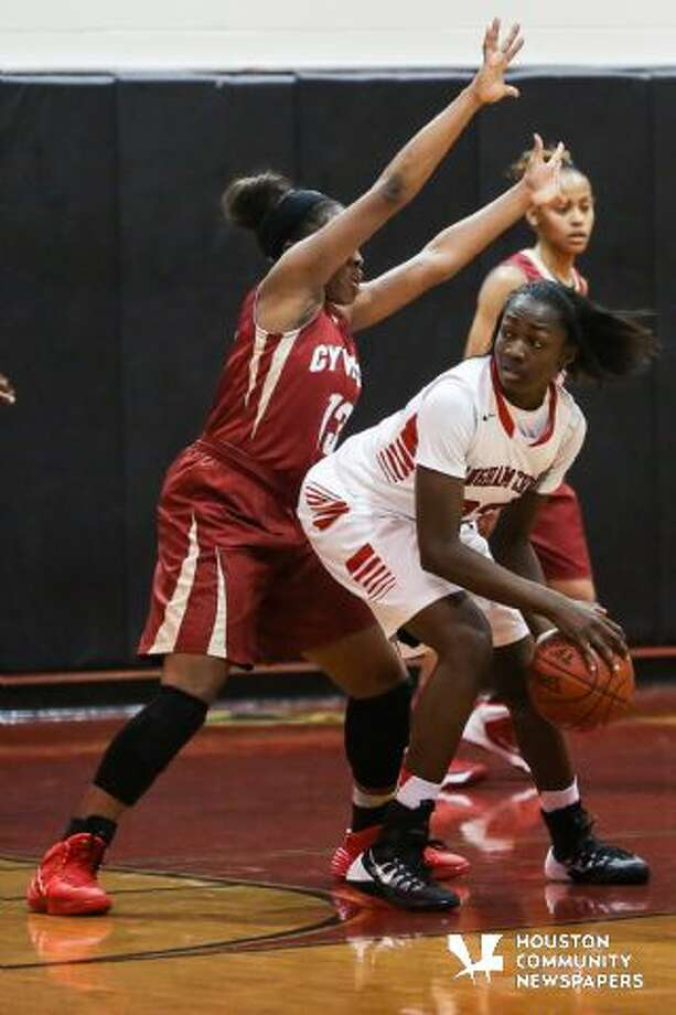 Langham Creek's Kayla Owens tries to post up Cy Woods' Erica Ogwumike during the Lobos' 34-26 win Friday at Langham Creek High School. Photo: Michael Minasi/HCN