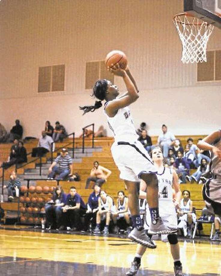Lady Bronco PhileCia Grant (10) goes up for a shot. Photo: CASEY STINNETT / @WireImgId=2655021