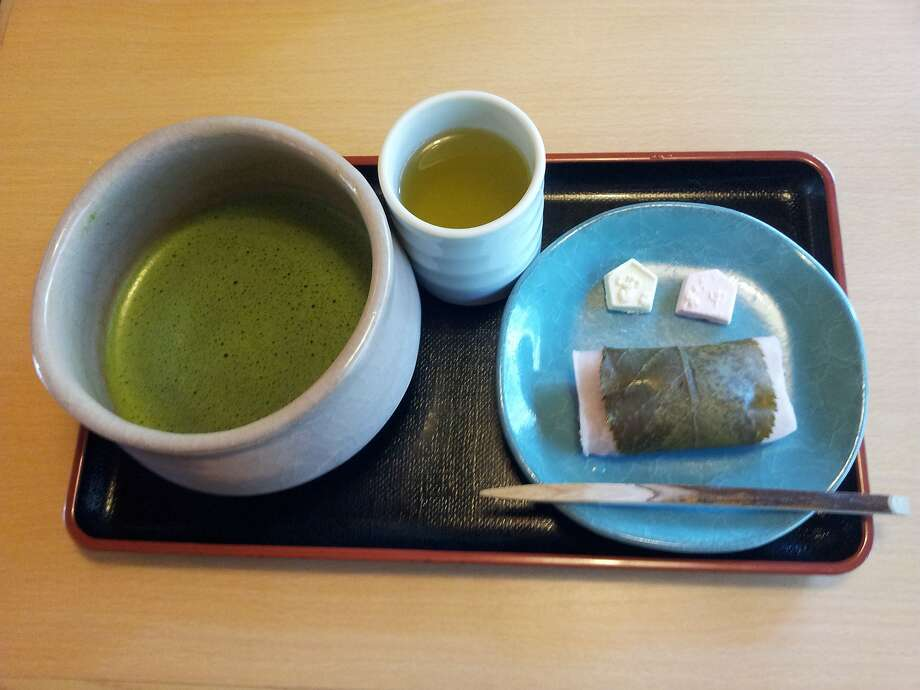 At a Japanese teahouse, a bowl of matcha, the thick tea ceremony green tea that is whisked to perfection, and served with a delicate sweet made of red bean paste and rice cake. Photo: Don George, Special To The Chronicle
