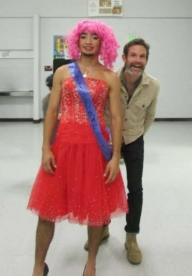 """Noah Diggs-Anglin as """"Skittles Bambi,"""" shown with COHS teacher Bill Stratton, won the 2013 Ms. Snowflake crown at the FFA Womanless Pageant fundraiser. Photo: Submitted Photo"""