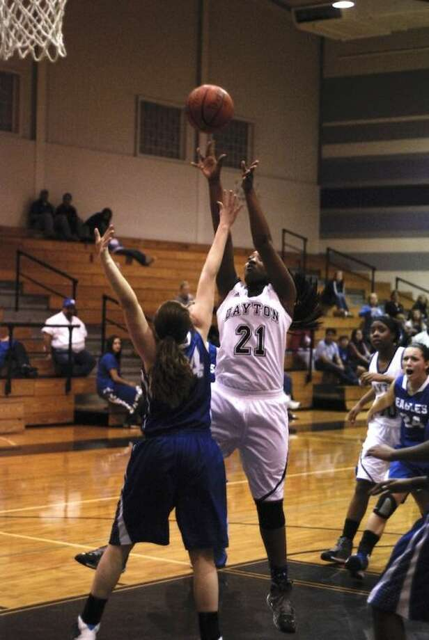 Londan Mallet (21) was high scorer for Dayton with 11 points Friday, Dec. 20, against Barbers Hill. Photo: CASEY STINNETT