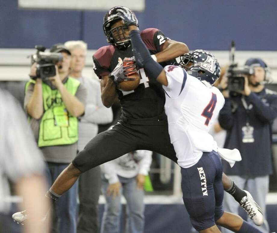 Pearland's Carter Jefferson catches a touchdown pass over Allen's Mayomi Olootu in the first half of the UIL Class 5A Division I state championship game on Saturday in Arlington. Allen won, 63-28.