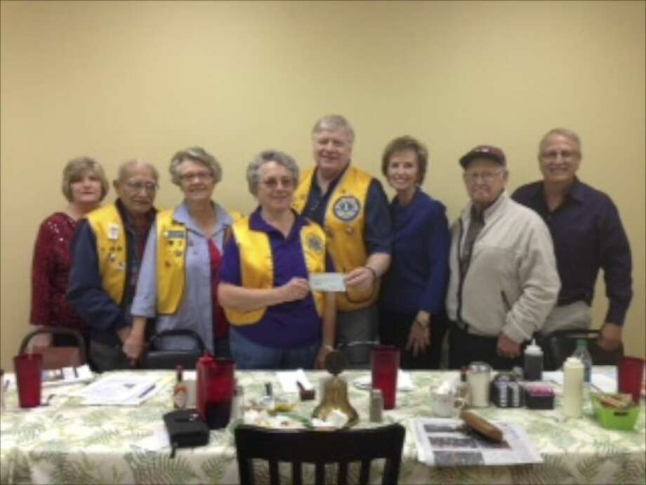 The Dayton Noon Lions Club donated $500 to the Dayton Community Food Pantry. In the picture from left to right are Glenda Williams, Joe Vargas, Linda Williamson, Joan Jones, Dr. David Beeler, Betty Williamson, Norbit Westmoreland and Alan Connor. Photo: Submitted Photo