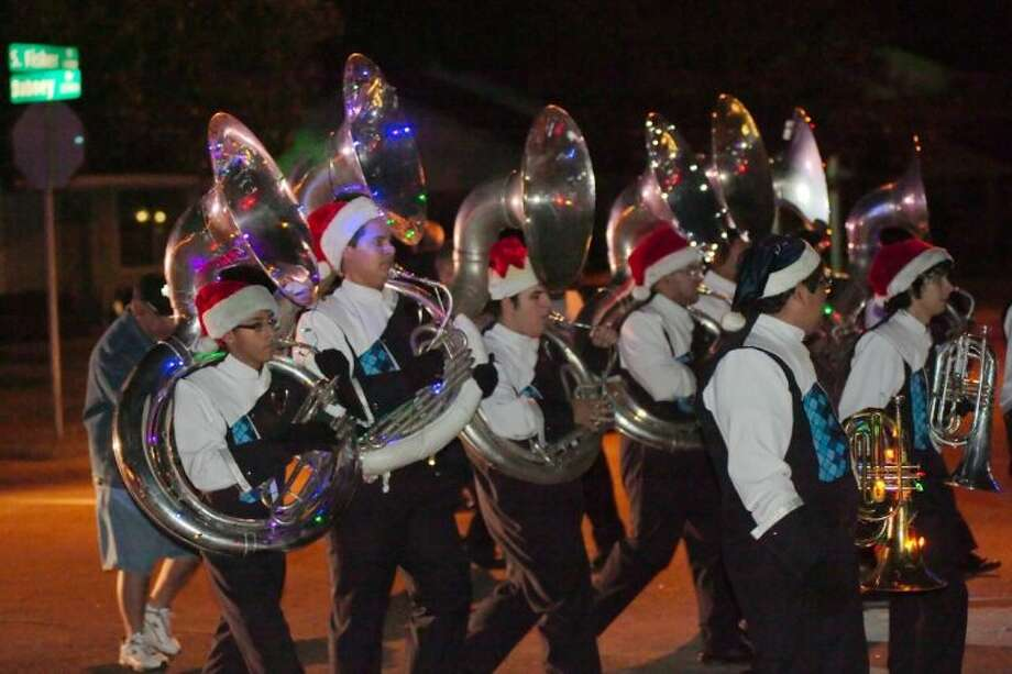 The tuba section plays as the Sam Rayburn High School Band participates in a march-a-thon as they march through a neighborhood near the school Wednesday, Dec. 18 to raise money for a band trip to Florida. Photo: KIRK SIDES