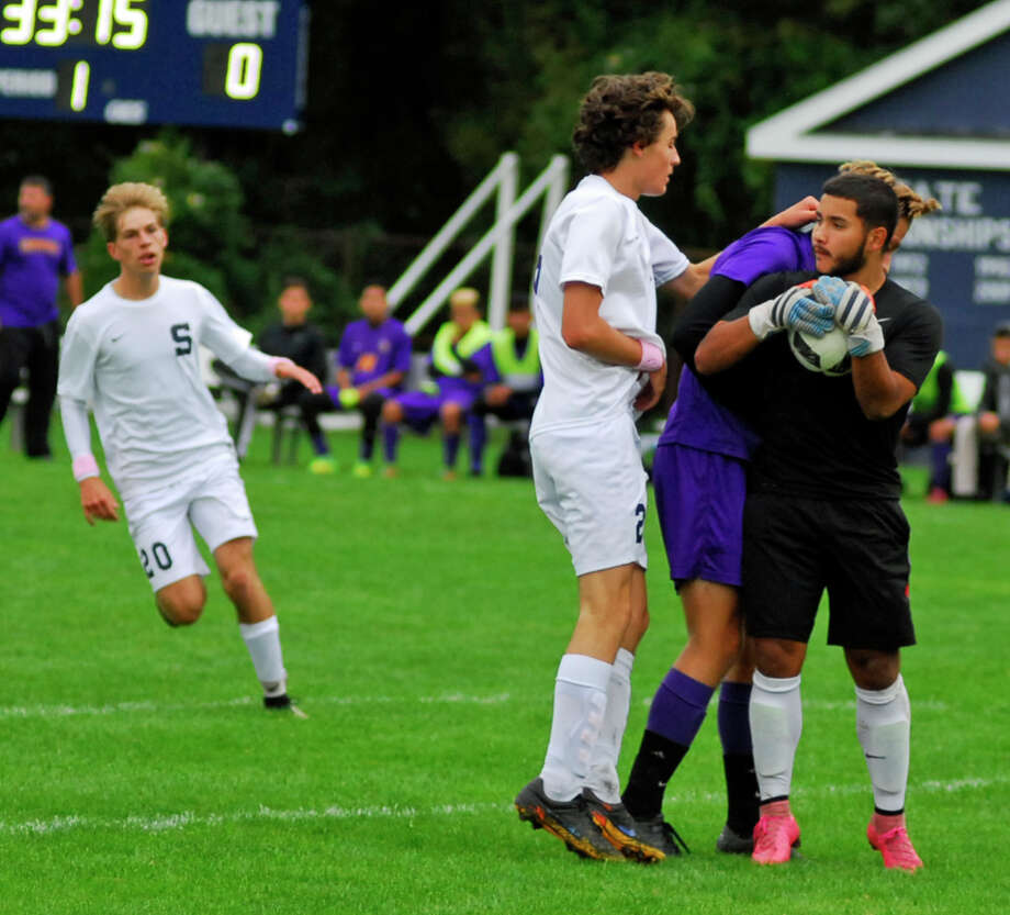 Westhill goalie Jeffrey Garcia collects the ball during a game against Staples on Saturday. Photo: Ryan Lacey / Hearst Connecticut Media