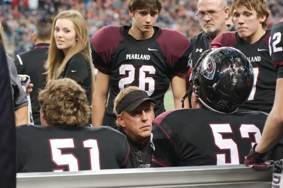 Pearland football coach Tony Heath speaks to Oiler center Jacob Hollas (53) on the sideline against Allen Saturday. Photo: KIRK SIDES