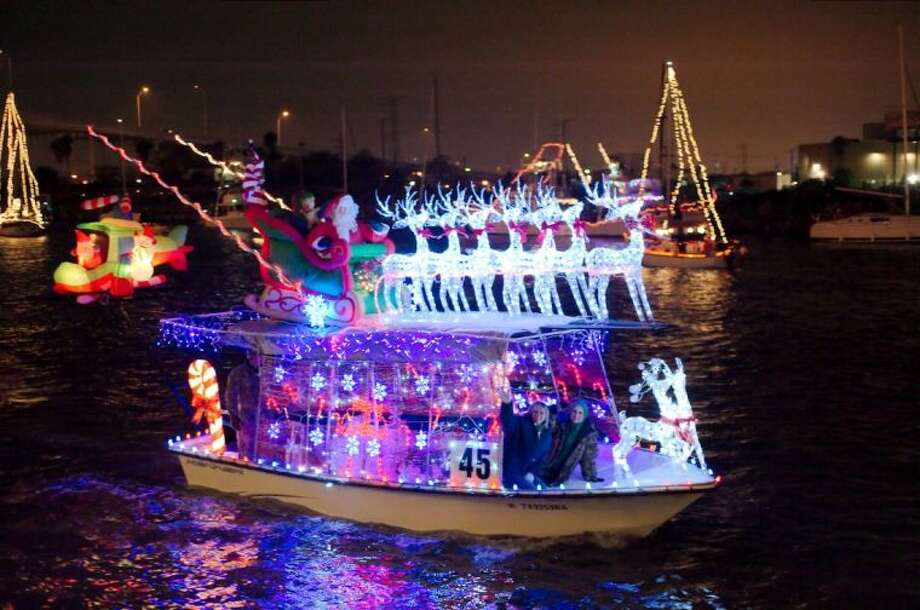 Loaded from bow to stern with Christmas decorations this boat heads out on parade.