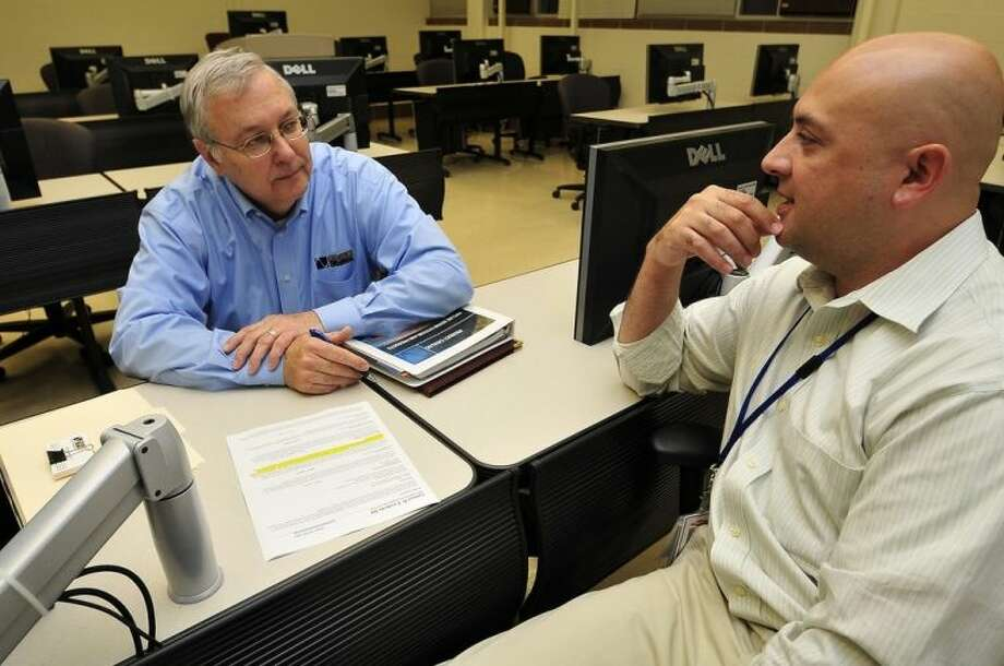 Pictured (left to right) are Wayne Hagemeister, director of engineering with Oil States Industries, interviews Sam Escobedo, an engineering design graphics student. Hagemeister, along with Robert Riggs, senior project engineer, recently visited San Jacinto College to meet with candidates for drafter positions. Photo credit: Jeannie Peng-Armao, San Jacinto College marketing, public relations, and government affairs department.