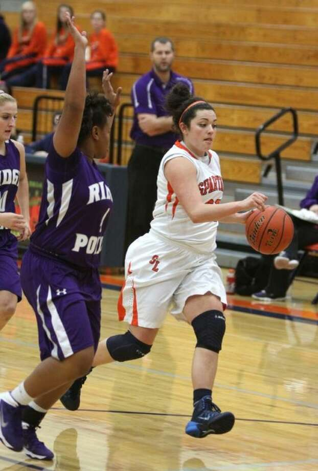 Seven Lakes' Katy Keese drives to the basket against Ridge Point's Ashlin Riggs at the Nike Classic at Seven Lakes High School. The Lady Spartans are 3-0 in district. Photo: Alan Warren