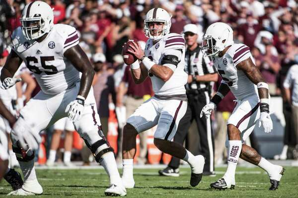 Texas A&M quarterback Trevor Knight, center, looks for a passing lane during the first half of an NCAA college football game against South Carolina Saturday, Oct. 1, 2016, in Columbia, S.C. (AP Photo/Sean Rayford)