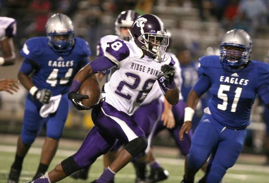 Ridge Point's Je'Marcus Johnson is chased by Willowridge's Willie Clay (44) and Nick Powell (51) during a District 22-4A game Oct. 17 at Hall Stadium in Missouri City. To view or purchase this photo and others like it, go to HCNPics.com. Photo: Alan Warren