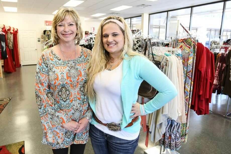 Dana Frazier(left) opened Six Shooter Junction, a boutique for women's clothing, shoes, purses and more, on the first week of November off of FM 1488 in Magnolia.