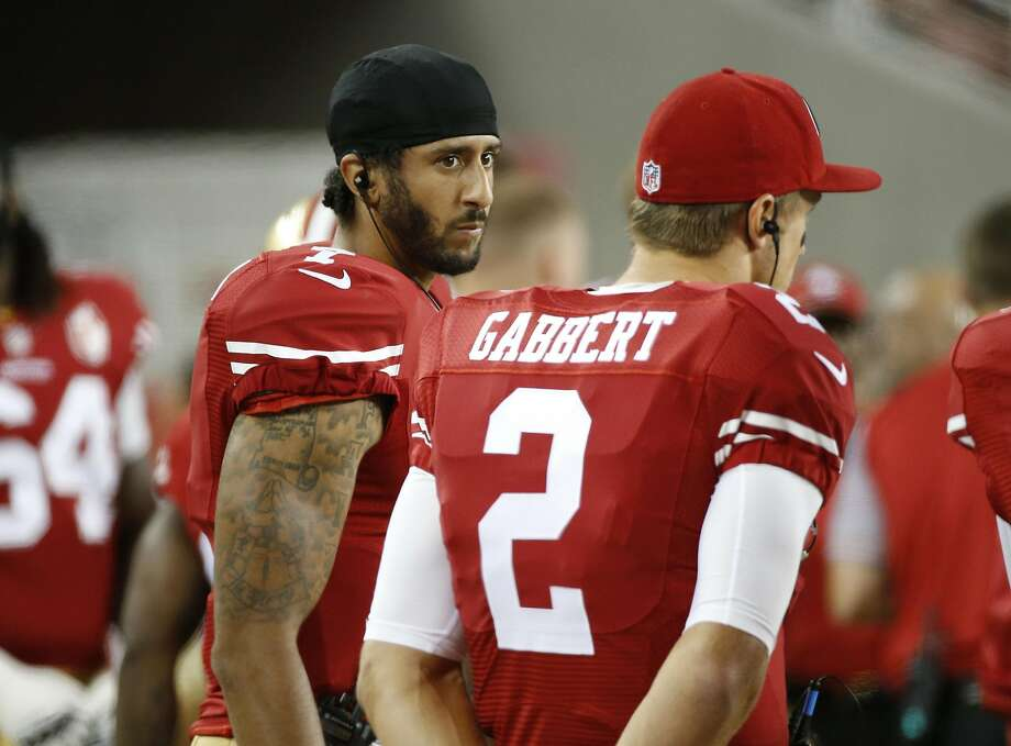 San Francisco 49ers quarterbacks Colin Kaepernick, left, and Blaine Gabbert stand on the sideline during the second half of an NFL preseason football game against the Green Bay Packers on Friday, Aug. 26, 2016, in Santa Clara, Calif. Green Bay won 21-10. (AP Photo/Tony Avelar) Photo: Tony Avelar, Associated Press
