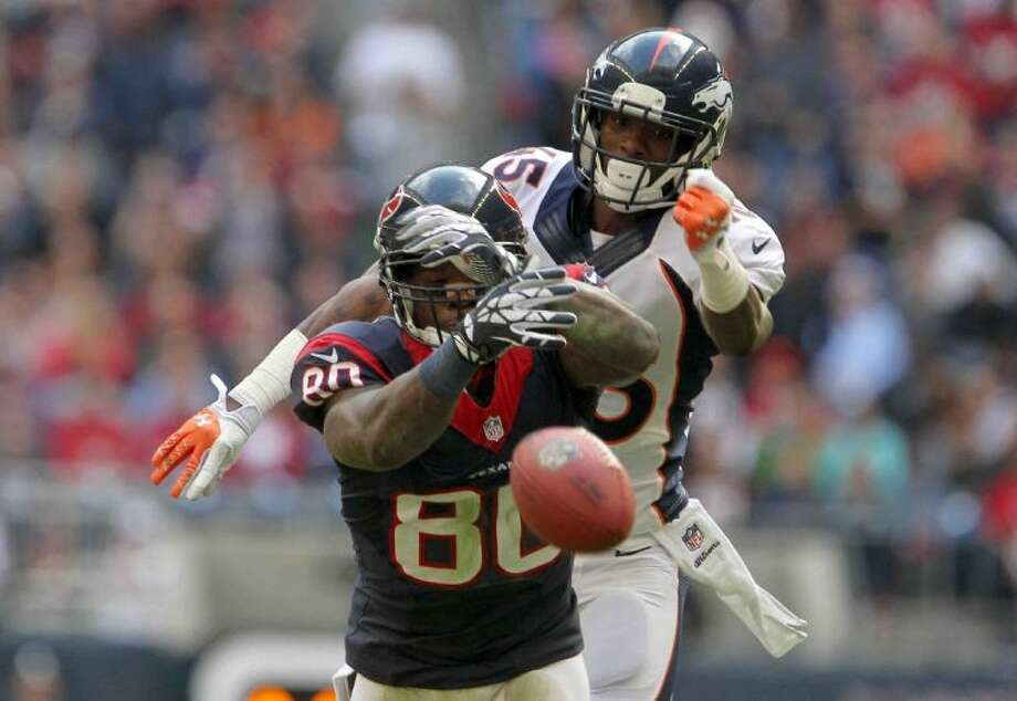 Texans receiver Andre Johnson can't come up with a second-half pass in Sunday's 37-13 loss to the Denver Broncos. The Texans close the season on Sunday on the road against the Tennessee Titans.