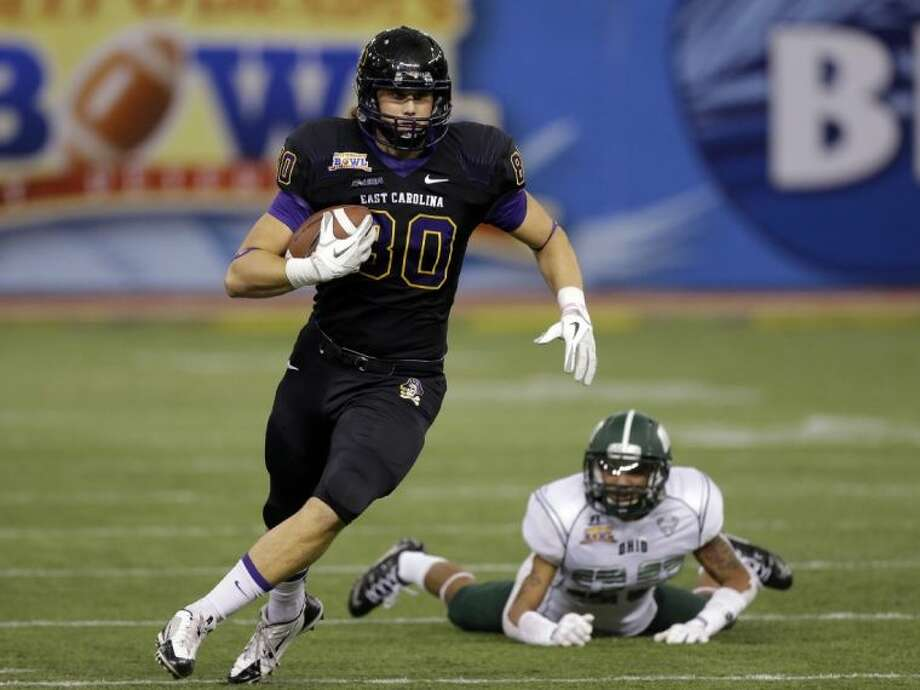 East Carolina wide receiver Bryce Williams (80) runs after catching the ball against Ohio during the third quarter of the Beef 'O' Brady's Bowl. East Carolina won 37-20.