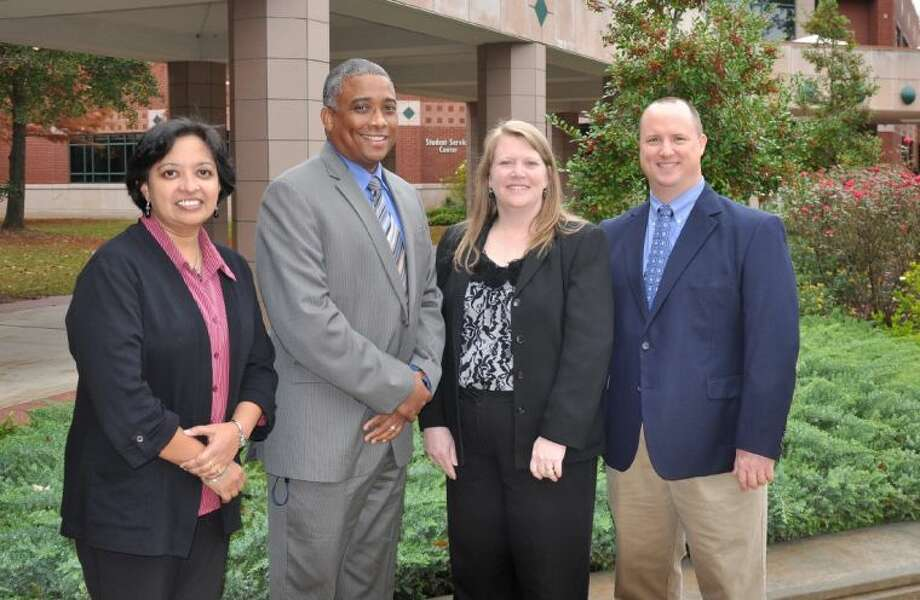 Four instructors at Lone Star College-Montgomery were recognized as Faculty Excellence Award recipients. This annual award distinguishes leaders in teaching excellence and innovation. Pictured, from left to right, are Anitha Iyer, professor of biology; Juan LeBron, faculty counselor; Amy Roberson, faculty counselor; and David Quarles, professor of math.