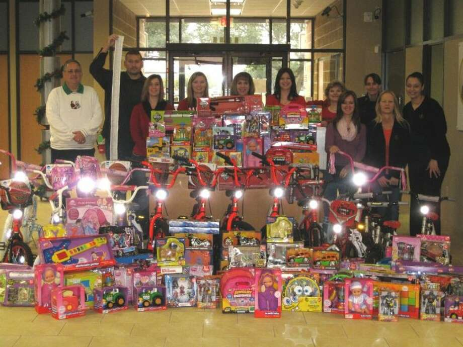 Gulf Coast Educators team members show off toys purchased for the toy drives for Pasadena, League City and Pearland police departments. Photo: SUBMITTED PHOTO