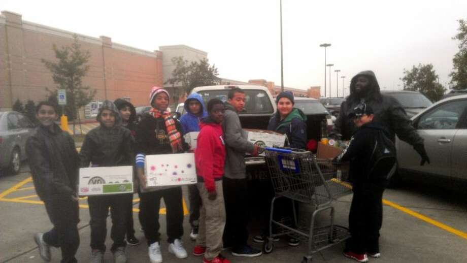 Members of Garcia's Male Mentors group during the recent food drive at the Highway 6/West Airport Krogers. Photo: Courtesy Garcia Middle School